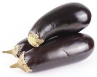 3 aubergines d'isolement Photos stock