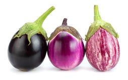 3 aubergines d'isolement sur un fond blanc Photographie stock
