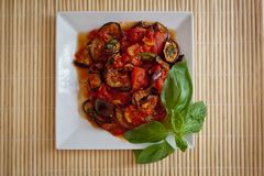 Aubergines in tomato sauce Royalty Free Stock Photos