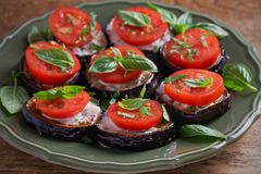 Aubergines with tomatoes and sauce. Pan fried eggplants. Healthy vegetarian food, appetizer. royalty free stock photo