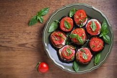 Aubergines with tomatoes and sauce. Pan fried eggplants. Healthy vegetarian food, appetizer. stock photography
