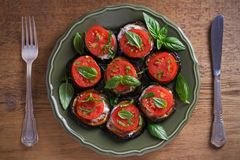 Aubergines with tomatoes and sauce. Pan fried eggplants. Healthy vegetarian food, appetizer. stock photo