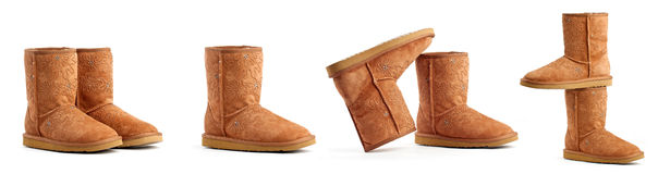Auburn ugg boots. On the white background, the same pair placed differently royalty free stock images
