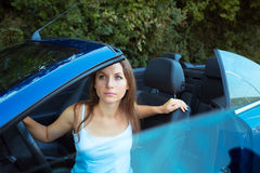 Сaucasian woman in a cabriolet car Royalty Free Stock Images