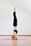 Сaucasian woman contortionist practicing gymnastic yoga Stock Photography