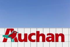 Auchan logo on a wall Royalty Free Stock Photos