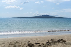 Auckland beach view. Narrow neck beach view with rangitoto island in the distance. Taken in Auckland, New Zealand Stock Photos