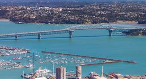 Auckland Blue Water Bridge. Blue clear water under Auckland harbour bridge Stock Photography