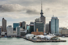Auckland City CBD, Sky Tower & Waterfront with dramatic sky Royalty Free Stock Photos