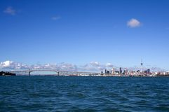 Auckland City, New Zealand By Day 2. Auckland City, New Zealand viewed from the water on a bright sunny day Royalty Free Stock Photos