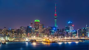 Auckland city skyline at night. With city center and Auckland Sky Tower, the iconic landmark of Auckland, New Zealand Stock Photo