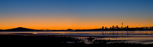 Auckland City Sunrise Panorama. A Panorama of Auckland City, Harbour Bridge and Rangitoto Island at Sunrise Stock Photography
