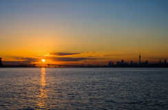 Auckland City Sunrise Silhouette. The sun rising behind Auckland City at dawn, New Zealand Stock Photos