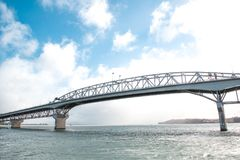 Auckland Harbor Bridge against blue sky in Auckland, New Zealand. stock photo