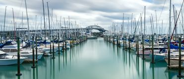 Auckland harbor bridge in Auckland, New Zealand. Auckland Harbour Bridge in Auckland, New Zealand, shot from Westhaven Marina using long exposure. The bridge Royalty Free Stock Photo