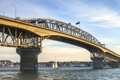 Auckland Harbour Bridge, Evening. Auckland Harbour Bridge in evening light with yacht passing under Stock Photography
