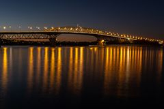 The Auckland harbour bridge lit up at night royalty free stock image