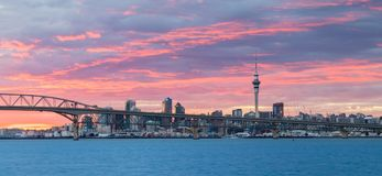 Auckland Harbour Sunrise Sky. Bridge over the City of Auckland with a wonderful clouded morning sky royalty free stock photo