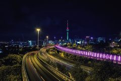 Auckland highway at night and city skyline. With Sky Tower Royalty Free Stock Photography