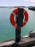 Auckland: life buoy on harbor wharf Stock Photo