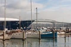 Auckland marina with harbor bridge in background Stock Image