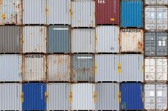 AUCKLAND, NEW ZEALAND - April 2, 2012: Stack of shipping containers of various brands and colors at sea port. Stock Photos