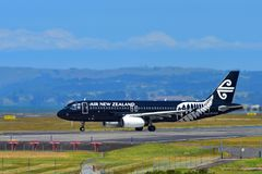 Air New Zealand Airbus A320 in All Blacks livery taxiing at Auckland International Airport. AUCKLAND, NEW ZEALAND - DECEMBER 17: Air New Zealand Airbus A320 in Stock Images