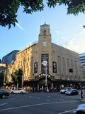 A view across the street of the famous Civic Theatre with a crowd of people lined up waiting to attend a show stock images
