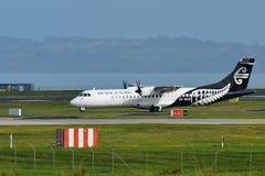 Air New Zealand Link ATR 72-500 turboprop aircraft taxiing at Auckland International Airport. AUCKLAND, NEW ZEALAND - JULY 10: Air New Zealand Link ATR 72-500 Stock Image