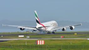 Emirates A380 super jumbo landing at Auckland International Airport Royalty Free Stock Photo