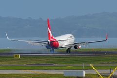 Qantas Airways Boeing 737 landing at Auckland International Airport. AUCKLAND, NEW ZEALAND - JULY 10: Qantas Airways Boeing 737 landing at Auckland International Stock Image