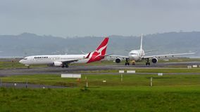 Qantas Airways Boeing 737 taxiing for departure at Auckland International Airport. AUCKLAND, NEW ZEALAND - JULY 10: Qantas Airways Boeing 737 taxiing for Stock Image