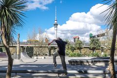 Auckland, New Zealand, NZ - September 20, 2017 - Male youth skat. Auckland, New Zealand, NZ - September 20, 2017 - Male youth or teenager skateboarding at Royalty Free Stock Images