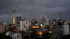 Auckland New Zealand skyline on stormy evening. Auckland is the largest Polynesian city in the worldZOOM OUT - Aerial view of unrecognizable workers with stock video footage
