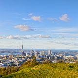 Auckland from Mount Eden. Auckland, New Zealand, from the volcano Mount Eden, the crater rim is in the foreground Royalty Free Stock Photo