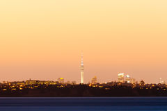 Auckland NZ distant citylight skyline after sunset Stock Photos