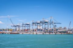 Auckland port with shipping containers, cranes and ship in New Z Royalty Free Stock Images
