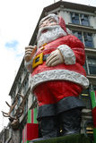 Auckland Queen Street Creepy Santa. Father Christmas looms over a street front with his reindeer and presents around him, New Zealand Royalty Free Stock Images