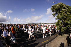 Auckland round the bays fun run. Participants of Auckland Round the Bays,one of the world's largest fun-runs with an estimated 70,000 entrants, in Auckland, New stock photos