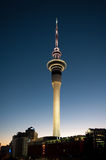 Auckland's Sky Tower at dawn. The iconic Sky Tower dominates Auckland's skyline, this shot at dawn, lighting lifts the tower from the inky background Stock Photo