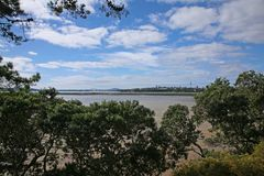 Auckland harbour and bridge from point chevalier. Auckland`s Waitemata Harbour, city and harbour bridge, as seen from the suburb of Point Chev Royalty Free Stock Photography