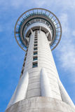 Auckland sky tower from below with blue sky background. Stock Photography