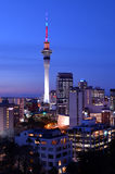 Auckland Sky tower in colors and the financial center skyline Royalty Free Stock Photo