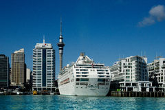 Auckland Skyline & Cruise Ship royalty free stock photography