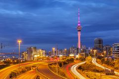 Auckland Skyline and Motorway. Auckland Motorway and Auckland Skyline, illuminated at twilight and with car headlight trails stock image