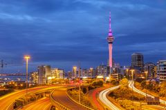 Auckland Skyline and Motorway. Auckland Motorway and Auckland Skyline, illuminated at twilight and with car headlight trails stock photography