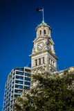 Auckland Town Hall. In the center of New Zealand's biggest city. The New Zealand flag flies on the top of this historic Building in the center of the city Royalty Free Stock Image