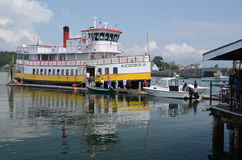 Aucocisco III boards passengers in Casco Bay, ME. The Aucocisco III provides ferry service in Casco Bay, Maine, ISA. It travels between various islands. The Royalty Free Stock Images