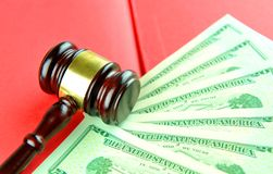 Auction. Concept with gavel on money background Royalty Free Stock Photography
