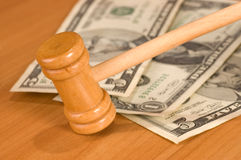 Auction-hammer. Wood auction hammer over different dollars banknotes Stock Images